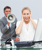 Charismatic manager yelling through a megaphone in his colleague — Stock Photo