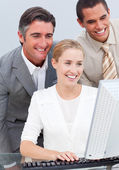 Self-assured business team working at a computer — Stock Photo