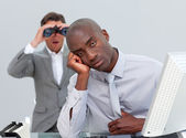 Ethnic businessman getting bored and his manager looking through — Stock Photo
