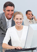 Smiling business team working in the office — Stock Photo