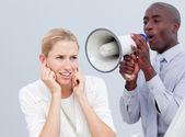 Ambitious businessman shouting through a megaphone — Stock Photo
