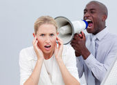 Furious businessman shouting through a megaphone — Stock Photo