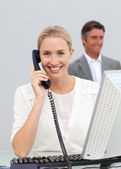 Beautiful businesswoman talking on phone — Stock Photo