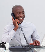 Afro-American businessman on phone in the office — Stock Photo