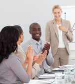Businesswoman standing smilling after a presentation — Stock Photo