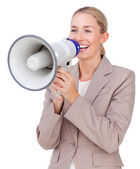 Attractive businesswoman shouting through a megaphone — Stock Photo