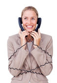 Charming businesswoman tangled up in phone wires — Stock Photo