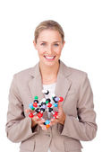 Smiling businesswoman holding a molecule — Stock Photo