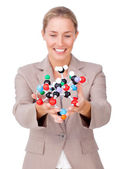 Assertive businesswoman showing a molecule — Stock Photo