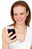 Positive businesswoman using a mobile phone — Stock Photo
