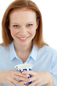 Portrait of a smiling businesswoman holding a cup of tea — Stock Photo