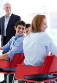 Smiling business discussing at a conference — Stock Photo
