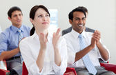 International business clapping at a conference — Stock Photo