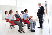 Senior businessman giving a conference — Foto Stock