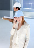 Attractive architect on phone — Stock Photo