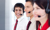 Young business with headsets on — Stock Photo
