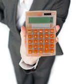 Close-up of a businesswoman holding a calculator — Stock Photo