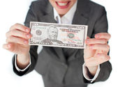 Close-up of a businesswoman holding cash — Stock Photo