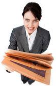 Assertive businesswoman reading a newspaper — Stock Photo