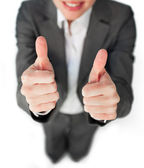 Close-up of a businesswoman with a thumbs up — Stockfoto