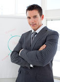 Young businessman reporting sales figures to his team — Stock Photo