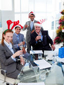 Manager and his team toasting with Champagne at a Christmas part — Stock Photo