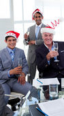 Confident businessmen wearing novelty Christmas hat — Stock Photo