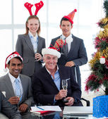 Smiling business wearing novelty Christmas hat — Stock Photo