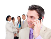 Portrait of a handsome businessman on phone — Stock Photo