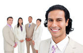 Portrait of latin businessman smiling with his team — Stock Photo