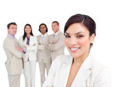 Portrait of latin businesswoman smiling with his team — Stock Photo