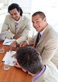 Smiling business co-workers in a meeting — Stock Photo