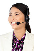 Young Asian customer service representative using headset — Stock Photo