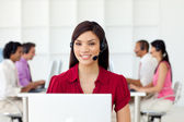 Charismatic Businesswoman with headset on — Stock Photo
