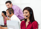 Smiling Customer service representative with headset on — Stock Photo