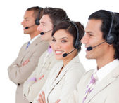 Assertive customer service representatives standing in a row — Stock Photo
