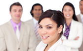 Charming female executive presenting her team — Stock Photo