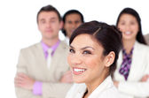Brunette female executive presenting her team — Stock Photo