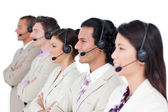 Confident business team lining up with headset on — Stock Photo