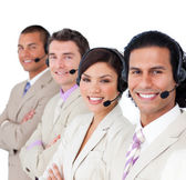 Smiling business team lining up with headset on — Stock Photo