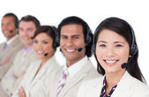 Enthusiastic business team lining up with headset on — Stock Photo