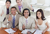 Successful business team with thumbs up — Stock Photo