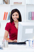Young businesswoman with headset on — Stock Photo