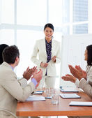 Successful asian woman giving a presentation — Stock Photo