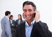 Portrait of smiling businessman on phone — Stock Photo