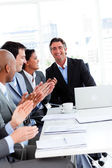 Team of successful business clapping — Stock Photo