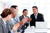 Smiling multi-ethnic business team applauding — Stock Photo