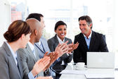 Happy business clapping in a meeting — Stock Photo