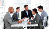 Multi-ethnic business disscussing a budget plan — Stock Photo
