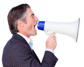 Businessman shouting instructions through a megaphone — Stock Photo